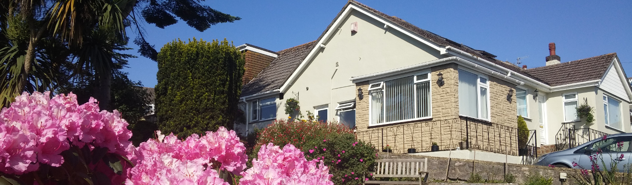 Churston Way Lodge - Exterior with Pink Flowers